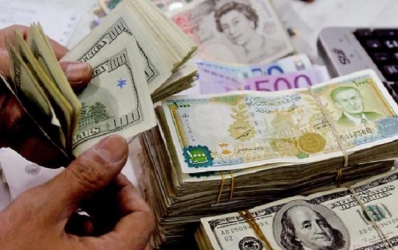 خبراء اقتصاد : هناك مخاوف من تخطي سعر الدولار الامريكي الـ 1000 ليرة سورية