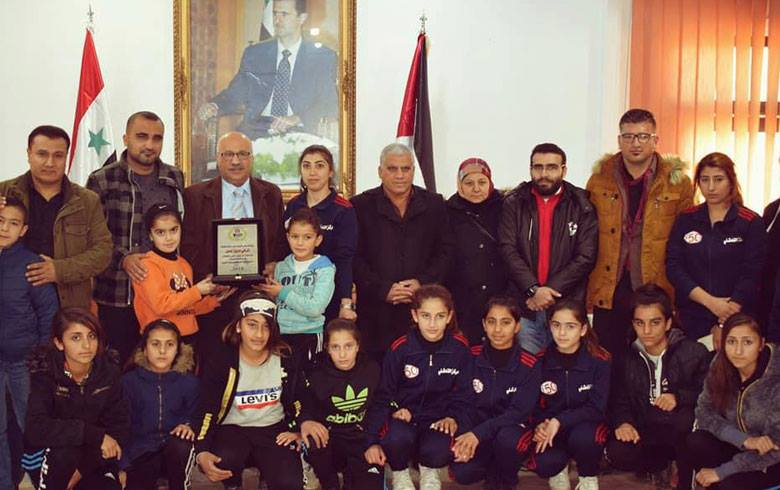 Honoring a leader in the Ba'ath Party in Qamishlo