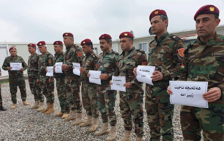 Roj Peshmerga in a pause tribute to the victims of the Halabja massacre