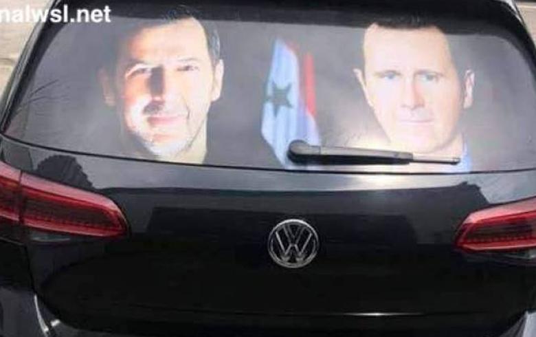 تعرف على صاحب السيارة التي تحمل صور بشار وماهر في شوارع ألمانيا