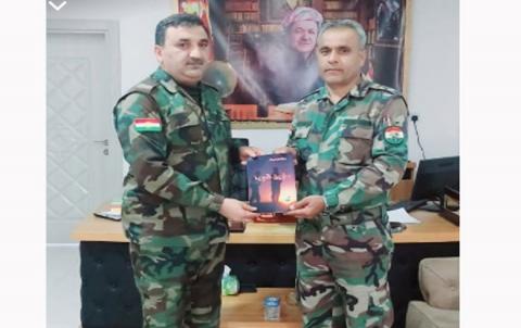 Peshmerga Abdul Hadi Darwish signs his book