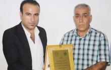 مخيّم قوشتبه... منظمة روج تكرّم الإعلامي علي عمر